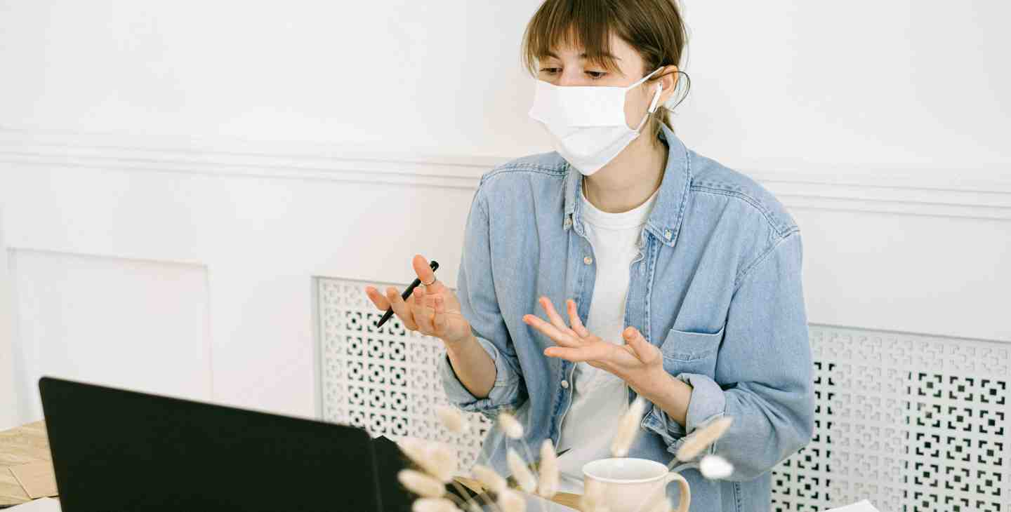 woman-in-face-mask-having-video-call-4240611.jpg